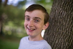 Joshua Osborn, now 15, outside his home in Cottage Grove, Wis